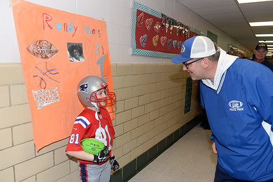 Pro Football Player, Randy Moss is portrayed by Antrim School Fifth Grader, Landon Schultz, as Point Pleasant Beach resident Sean Hennessy looks on at the Antrim Innovation Fair on 03/14/2019. (STEVE WEXLER/THE OCEAN STAR).