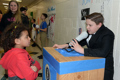 Young Declan Griffith listens as 5th Grader, Gabe Pavone portrays John Fitzgerald Kennedy at the Antrim Innovation Fair at the Antrim Elementary School in Point Pleasant Beach, NJ on 03/14/2019. (STEVE WEXLER/THE OCEAN STAR).