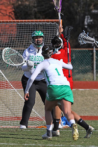 Goalie Kasey Wilson (center) waits for the ball as Brick Township High School hosted Manalapan High School for a girls varsity lacrosse game on Thursday March 28, 2019 (MARK R. SULLIVAN /THE OCEAN STAR)