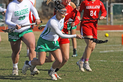 Lexie Laurino corrals the ball as Brick Township High School hosted Manalapan High School for a girls varsity lacrosse game on Thursday March 28, 2019 (MARK R. SULLIVAN /THE OCEAN STAR)