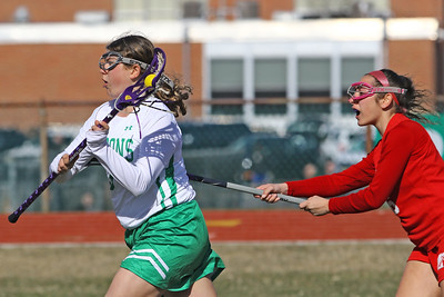 Savannah Eichert (left) gets past the Manalapan defense for a first half goal as Brick Township High School hosted Manalapan High School for a girls varsity lacrosse game on Thursday March 28, 2019 (MARK R. SULLIVAN /THE OCEAN STAR)