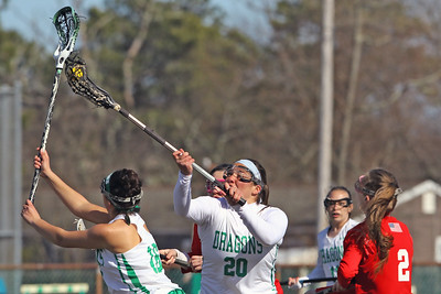 Ryleigh Finelli (center) garbs the ball during the face off as Brick Township High School hosted Manalapan High School for a girls varsity lacrosse game on Thursday March 28, 2019 (MARK R. SULLIVAN /THE OCEAN STAR)