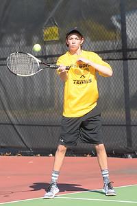 Jackson Tremblay, Varsity Tennis player for Point Plesant Boro High School returns a serve by a Brick Memorial Hiogh School player on 04/04/2019. (STEVE WEXLER/THE OCEAN STAR).