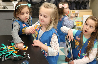 "Breelyn Mattia, Elliana Mizer, and Molly Hillman The Daisey Scouts making ""Blessing Bags"" at Nellie Bennett Elelmentary in Point Pleasant Boro, NJ on 4/4/19. [DANIELLA HEMINGHAUS | THE OCEAN STAR]"