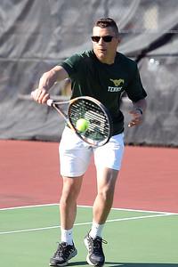 Caleb Alverado, Brick Memorial High School Varisty Tennis player returning a Point Pleasant Boro High School player's shot on 04/04/2019. (STEVE WEXLER/THE OCEAN STAR).