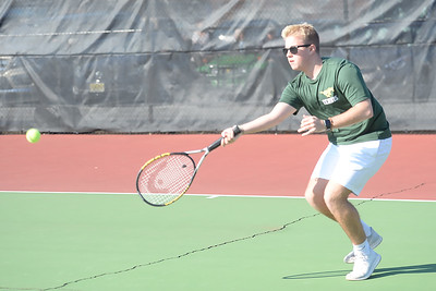 Return volley to Point Pleasant Boro player by Ray LaPoint of the Brick Mermorial High School Boy's Varsity Tennis Team on 04/04/2019. (STEVE WEXLER/THE OCEAN STAR).
