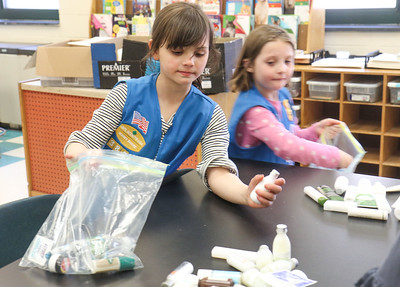 """Emma Lawrence and Gennive Hogan The Daisey Scouts making """"Blessing Bags"""" at Nellie Bennett Elelmentary in Point Pleasant Boro, NJ on 4/4/19. [DANIELLA HEMINGHAUS 