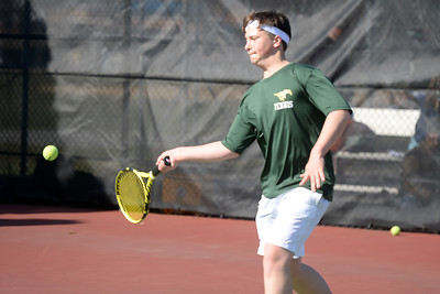 Jared Abazia of the Brick Memorial High School Boy's Varsity Tennis Team returns a serve to his Point Pleasant Boro High School opponent in their match played on 04/04/2019. (STEVE WEXLER/THE OCEAN STAR).