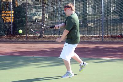 Jake Winstead of the Brick Memorial High School Boy's Varsity Tennis Team returns the ball to a waiting Point Pleasant Boro High School player on 04/04/2019. (STEVE WEXLER/THE OCEAN STAR).