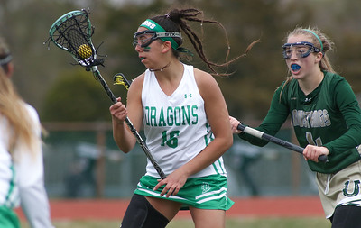 no.16, Mikayla Oliveira and no.4, Summer Castiglione Brick v/s Brick Memorial girl's lacrosse in Brick, NJ on 4/11/19. [DANIELLA HEMINGHAUS   THE OCEAN STAR]