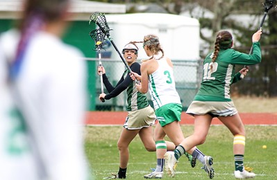 Nikki Owen attempting to pass to Carly Marotta Brick v/s Brick Memorial girl's lacrosse in Brick, NJ on 4/11/19. [DANIELLA HEMINGHAUS   THE OCEAN STAR]