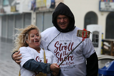"""The Stroll to the Shore for a Cure charity walk to help fight multiple Myeloma took place along the Jenkinson's Boardwalk  in Point Pleasant Beach on Sunday April 15, 2018. Donna and Rich Sanborn of Point Pleasant Borough take a """"selfie"""" as they brave the wind and the rain to take part in the walk.  (MARK R. SULLIVAN /THE OCEAN STAR)"""