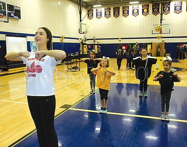 Bay Head Elementary School Open House 04/01/2017 from L to R: Mikala Wegvzyhiak age 17 from Point HS leading the BH ES cheer club in rehearsal