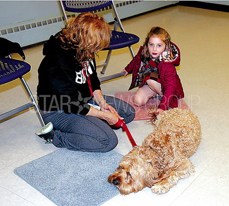 Brick Read to dogs 04/21/2017 from L to R: Jill Nydam from Toms River, Harbor Labradoodle Service Dog, Tova Kurtz age 5 from Lakewood