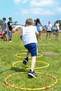 First graders run through hula hoops during the Time Travel event at Antrim Elementary's Field Day on June 6, 2019. [ALYSSA RASP | THE OCEAN STAR]