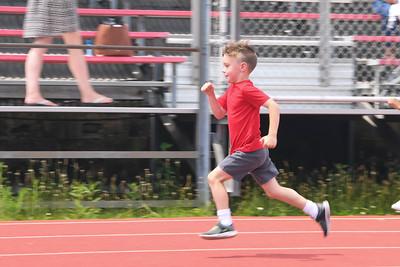 Kindergartener Teddy Highton leads the 100-Yard Dash at Antrim Elementary's Field Day on June 6, 2019. [ALYSSA RASP   THE OCEAN STAR]