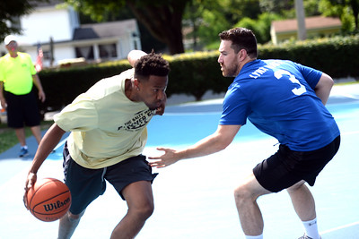 Beach Hoops team member James Cooper drives on a Lynx Waste team player at Indian Hill Park, in Manasquan, NJ on 06/28/2019. (STEVE WEXLER/THE COAST STAR).