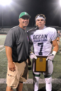 Brick High School Coach Jay Groschel and Cole Groschel at conclusion fo the 2019 All-Shore Gridiron Classic, played in Long Branch, NJ on 07/12/2019. (STEVE WEXLER/THE OCEAN STAR).