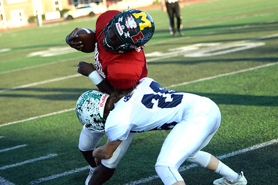 Defensive Back #26 Mike McGuigan of Brick High School and playing on the Ocean County All Shore Team, makes a Tackle on a Monmouth County Team player at the 2019 Gridiron Classic at Long Branch High School, Long Branch, NJ on 07/12/2019. (STEVE WEXLER/THE OCEAN STAR).