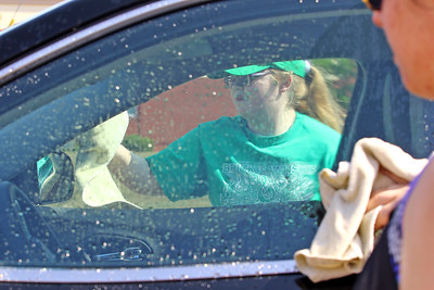 Holly Tkack works on drying a car as volunteers and members of the Brick Township high School Marching Band Caravan help out during a benefit car wash for the band held at the Exxon gas station on the corner of Drum Point Rd and Hooper Ave. in Brick on Sunday July 21, 2019. (MARK R. SULLiVAN/ THE OCEAN STAR)