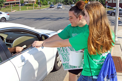 Paige Hangain and Lily Graziano collect donations as volunteers and members of the Brick Township high School Marching Band Caravan help out during a benefit car wash for the band held at the Exxon gas station on the corner of Drum Point Rd and Hooper Ave. in Brick on Sunday July 21, 2019. (MARK R. SULLiVAN/ THE OCEAN STAR)