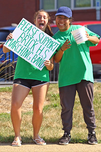 Stephanie Manfredi and Alicia Herrera try and drum up business as volunteers and members of the Brick Township high School Marching Band Caravan help out during a benefit car wash for the band held at the Exxon gas station on the corner of Drum Point Rd and Hooper Ave. in Brick on Sunday July 21, 2019. (MARK R. SULLiVAN/ THE OCEAN STAR)
