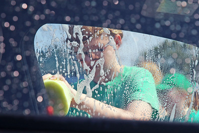 Volunteers and members of the Brick Township high School Marching Band Caravan help out during a benefit car wash for the band held at the Exxon gas station on the corner of Drum Point Rd and Hooper Ave. in Brick on Sunday July 21, 2019. (MARK R. SULLiVAN/ THE OCEAN STAR)