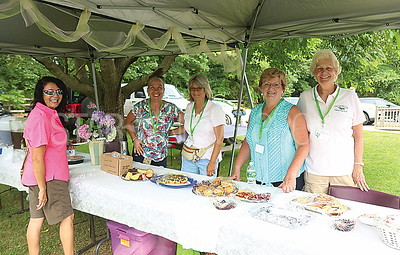 Brick garden tour// Bernie Knapp Master Gardener from Toms River purchasing some snacks from Janet Wolchko. Ellen Glass. Bonnie Chankalian and Peggy Voss