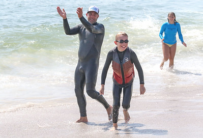 [L-R]: James Enze, from lavallette, Ethan Buge, from Dallas TX, and Malia Enze, from Lavallette. Waves of Impact day 1 in Lavallette, NJ on 8/1/19. [DANIELLA HEMINGHAUS]