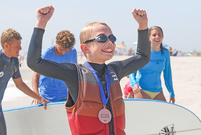Ethan Buge, from Dallas TX, celebrating. Waves of Impact day 1 in Lavallette, NJ on 8/1/19. [DANIELLA HEMINGHAUS]