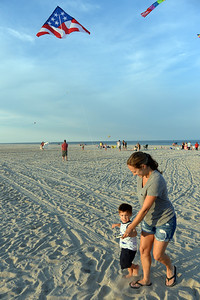 2 Year old Rocco Devito of Lavallette, NJ gets a hand from his Aunt Deanna Simone with his kite at the Kites and Castles event on Lavallette Beach, on 08/01/2019. (STEVE WEXLER/THE OCEAN STAR).