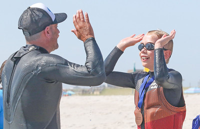 [ on right] Ethan Buge, from Dallas TX, celebrating with James Enze, from lavallette. Waves of Impact day 1 in Lavallette, NJ on 8/1/19. [DANIELLA HEMINGHAUS]