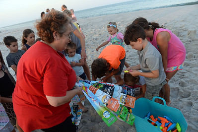 Jackie O'Leary hands out gifts to the attendees at the Kites and Castles Event on Lavallette B, in Lavallette. NJ on 08/01/2019. (STEVE WEXLER/THE OCEAN STAR).