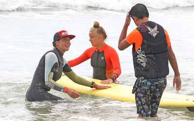 [L-R]: Beach surf team coach Christina Wetzel, surfer Ella Betten, and Christian Gamble. The Point Pleasant Beach surf team at the POAC event in Island Beach State Park, NJ on 8/8/19. [DANIELLA HEMINGHAUS]