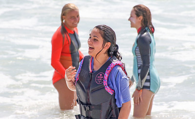 [L-R]:surfer Ella Betten,  Emily Kolchin, from Lanoka Harbor, and surfer Olivia Kesselhault. The Point Pleasant Beach surf team at the POAC event in Island Beach State Park, NJ on 8/8/19. [DANIELLA HEMINGHAUS]