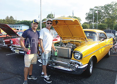 boro car show// Rotary Representative Anthony Petrocelli and friend Tony Galioto of Toms RIver with his 57 chevy 210 hardtop