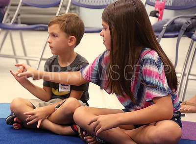 brick sign language // Emily Kozemchak 11 helped little brother Ethan 6 with the signs