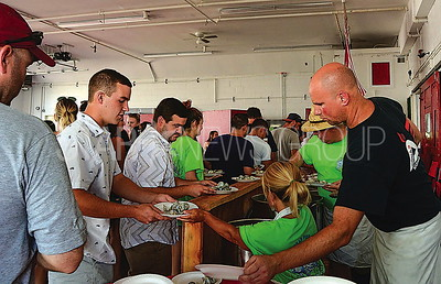 far right: maggi schwarz and glen brown serving food.