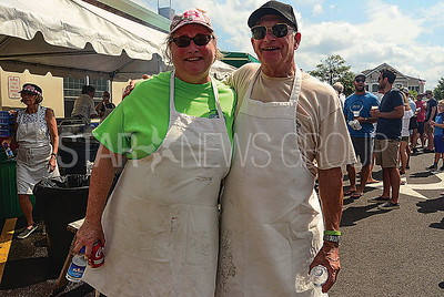 l-r:carol tilson and edwin griffin of bayhead and sea girtworking as cooks.