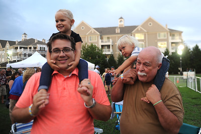 Point Pleasant Beach residents, Dad John Dougherty and Grandfather Mark Zoller, have their hands full with the kids Madison and Jack Dougherty at the Centennial Kickoff Celebration, in Point Pleasant Boro, NJ on 08/23/2019. (STEVE WEXLER/THE OCEAN STAR).