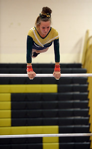 HANNAH RICHARDSON OF THE BRICK MEMORIAL GYMNASTICS TEAM TAKES HER TURN AT THE UNEVEN PARRALLEL BAR DURING BRICK MEMORIAL HIGH SCHOOL'S MATCH AGAINST TOMS RIVER NORTH HIGH SCHOOL VARSITY GYMNASTICS TEAM AT BRICK MEMORIAL HIGH SCHOOL IN BRICK, NEW JERSEY ON 09/20/2018. (STEVE WEXLER/THE OCEAN STAR).