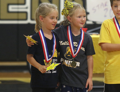 "1rst graders: Kylie Hutchinson and Amelia Colby getting their medals. Nellie Bennett Elementary School's ""Star Student Pep-Rally in Point Pleasant Boro, NJ on 9/21/18. [DANIELLA HEMINGHAUS 