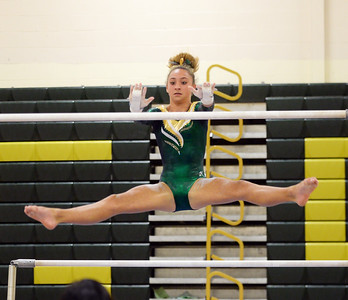 ABBY KENNEY OF THE BRICK MEMORIAL HIGH SCHOOL VARSITY GYMNASTICS TEAM GOES THROUGH HER UNEVEN PARALLEL BARS ROUTINE DURING BRICK'S MATCH AGAINST THE TOMS RIVER NORTH HIGH SCHOOL TEAM AT BRICK, NEW JERSEY ON 09/20/2018. (STEVE WEXLER/THE OCEAN STAR).