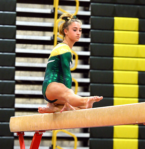 ABBY KENNY OF THR BRICK MEMORIAL HIGH SCHOOL VARSITY GYMNASTICS TEAM AT THE BEGINNING OF HER BALANCE BEAM ROUTINE IN A MEET AGAINST TOMS RIVER NORTH HIGH SCHOOL IN BRICK, NEW JERSEY ON 09/20/2018. (STEVE WEXLER/ THE OCEAN STAR).