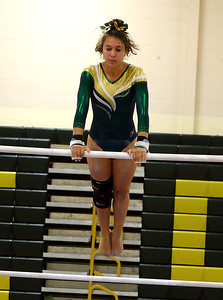 TIANA CIMINO OF THE BRICK MEMORIAL HIGH SCHOOL VARSITY GYMNASTICS TEAM TAKES HER TURN ON THE UNEVEN PARRALLEL BARS DURING THE MATCH AGAINST TOMS RIVER NORTH HIGH SCHOOL AT BRICK MEMORIAL HIGH SCHOOL, BRICK, NEW JERSEY ON 09/20/2018. (STEVE WEXLER/THE OCEAN STAR)