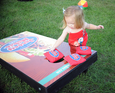 FRANNIE DAVIDOSKI AGE 21 MONTHS OF POINT PLEASANT BORO, NEW JERSEY DISPLAYS HER TECHNIQUE IN THE CORNHOLE GAME OFFERED AT ROCK FOR AWARENESS AT COMMUNITY PARK IN POINT PLEASANT BORO ON 09/29/2018. (STEVE WEXLER/THE OCEAN STAR).