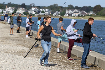 The Brick Memorial High School finishing team is technically part of the physical education course at the school. Tim Brennan , a gym teacher at the school introduced the course to the curriculum. Brennan takes the team to the Point Pleasant Beach Inlet for a morning of fishing on Thursday September 27, 2018. (MARK R. SULLIVAN /THE OCEAN STAR)