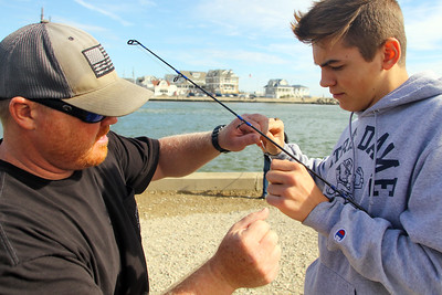 The Brick Memorial High School finishing team is technically part of the physical education course at the school. Tim Brennan , a gym teacher at the school introduced the course to the curriculum. Brennan takes the team to the Point Pleasant Beach Inlet for a morning of fishing on Thursday September 27, 2018.Here Brennan (left) helps Justin Bialobelocki with tying a albright knot. (MARK R. SULLIVAN /THE OCEAN STAR)