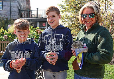 james, andrew, and christine mcLeod, howell, with their newly blesses pets.