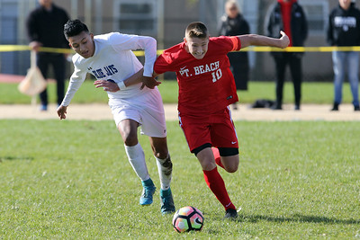 Li Costa (right) from Point Pleasant Beach battles with Diego Ortiz (right) from Middlesex as  Point Pleasant Beach High School hosted Middlesex High School first round of the NJSIAA Central Jersey Group I State Boys Soccer Tournament held in Point pleasant beach on Monday October 29, 2018. (MARK R. SULLIVAN/THE OCEAN STAR)